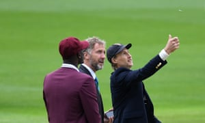 England captain Joe Root performs the toss alongside West Indies captain Jason Holder and match referee Chris Broad.