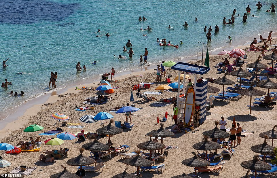 Holidaymakers return toPortals Nous in Mallorca yesterday as Spain starts to return to normal