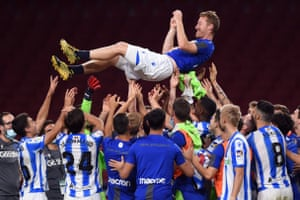 David Zurutuza of Real Sociedad is thrown in the air by his teammates after the match against Atlético Madrid.