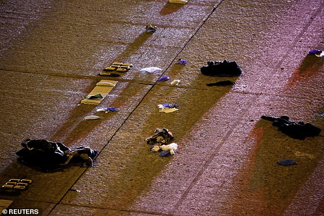 Articles of clothing and other items are seen strewn on Interstate 5 in Seattle after the collision early on Saturday morning