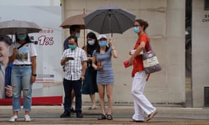 People are seen in a street of Wan Chai in south China's Hong Kong, 29 July 2020.