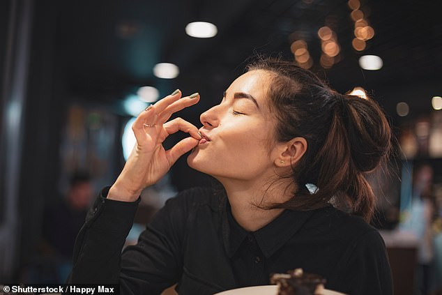 Scientists found it took participants 34 seconds to eat five squares of chocolate when listening to fast music. Slow music was four seconds longer (stock)