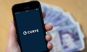 Someone uses the Curve banking app on a mobile phone.