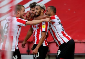 Emiliano Marcondes (second left) is congratulated by his teammates.
