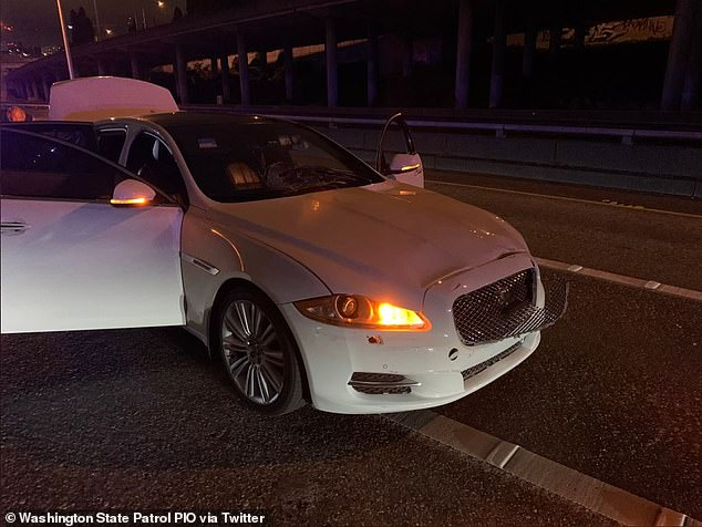Washington State Patrol released two images (one of them seen above) of the white Jaguar. The image shows damage to the front of the vehicle