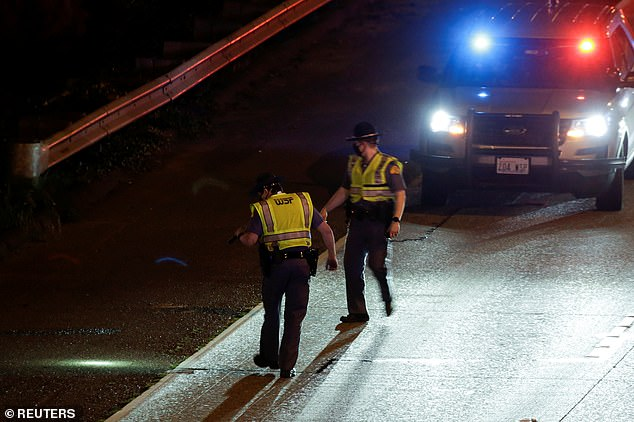 Washington State Patrol officers investigate the scene after the collision in Seattle early on Saturday morning