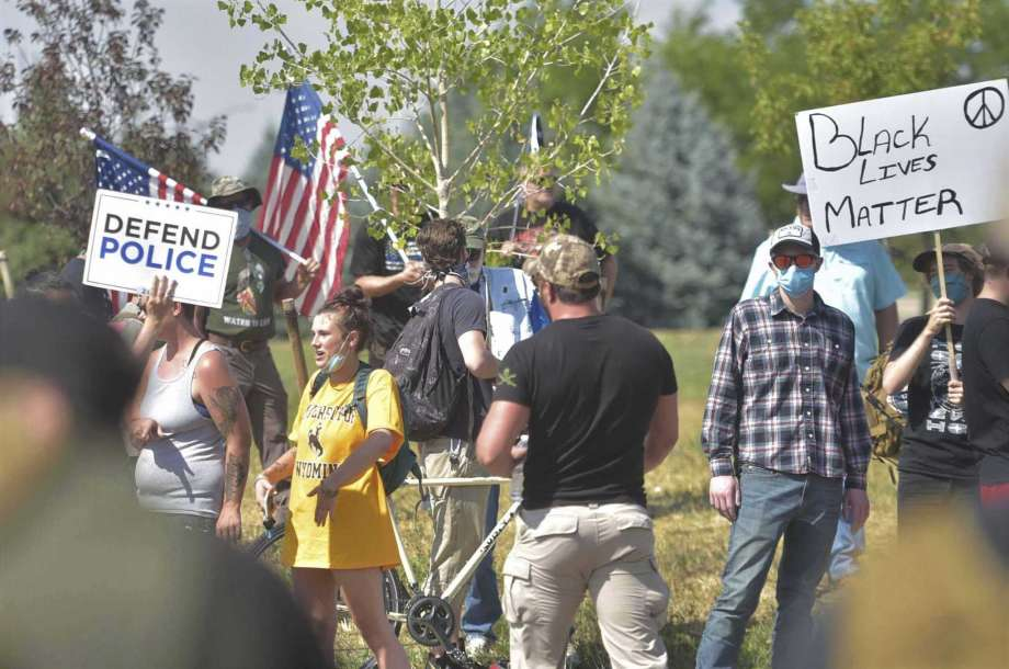 "People participate in a defend the police rally outside the Fort Collins Police Services building on Saturday, Aug. 8, 2020, in Fort Collins, Colo. Three people were arrested and another cited after fights broke out at a Colorado pro-police rally that attracted counter protesters, authorities said. The ""Back the Blue"" rally drew hundreds of people outside the Fort Collins police department Saturday afternoon. (Kevin Lytle/Fort Collins Coloradoan via AP) Photo: Kevin Lytle, AP / The Coloradoan"