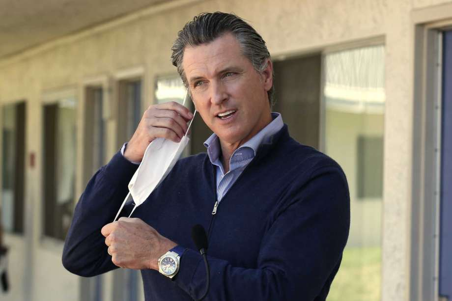 FILE - In this June 30, 2020, file photo, Gov. Gavin Newsom removes his face mask before giving an update on the state's initiative to provide housing for homeless Californians amid the coronavirus pandemic, during a visit to Pittsburg, Calif. Newsom has had a summer of muddled messaging and bad news in the coronavirus fight, a trend crystallized by the governor's delayed response to a data error that caused a backlog of nearly 300,000 virus test results. Photo: Rich Pedroncelli, AP / Copyright 2020 The Associated Press. All rights reserved