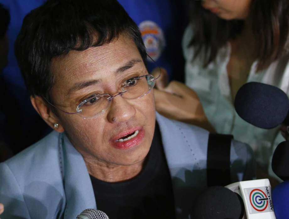FILE - Maria Ressa, the award-winning head of a Philippine online news site Rappler, talks to the media after posting bail at a Regional Trial Court following an overnight arrest by National Bureau of Investigation agents on a libel case in Manila, Philippines on Feb. 14, 2019. A new documentary tracks Ressa's dual life in recent years. She's seen smiling while accepting international honors and praise from the likes of George Clooney, then grimly facing down online harassment, legal action and real world threats for her news site's reporting on the drug war waged by President Rodrigo Duterte. Photo: Bullit Marquez, AP / Copyright 2020 The Associated Press. All rights reserved.