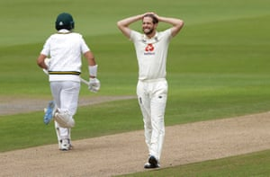 Woakes reacts as Masood edges through the slips.
