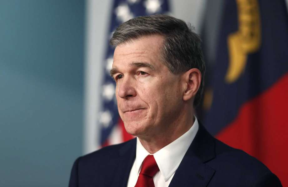 FILE - Gov. Roy Cooper listens to a question during a briefing at the Emergency Operations Center in Raleigh, N.C., Tuesday, July 14, 2020, amid the coronavirus pandemic. Cooper will discuss the pandemic, education and his re-election bid in an interview with The Associated Press on Thursday, Aug. 6. (Ethan Hyman/The News & Observer via AP, File) Photo: Ethan Hyman, AP / 2020, The News & Observer