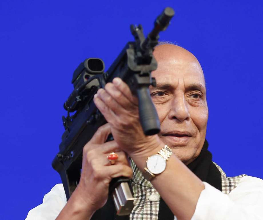 FILE- In this Feb. 7, 2020 file photo,  Indian Defense Minister Rajnath Singh holds a model of a light machine gun during DefExpo20 in Lucknow, India. India will ban the imports of 101 items of military equipment in an effort to boost indigenous production and improve self-reliance in weapons manufacturing, Singh said Sunday. Photo: Rajesh Kumar Singh, AP / Copyright 2020 The Associated Press. All rights reserved.