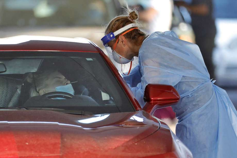 A person is tested for the COVID-19 Coronavirus Tuesday, July 28, 2020 at Cesar Chavez City Park in Phoenix. The two-week testing event is aimed at bringing tests to Phoenix's Laveen neighborhood, home to many Latinos and Blacks who have been disproportionately affected by the coronavirus. Latino leaders say governments need to do more to communicate effectively with Hispanic communities to ensure people know where to get tested and encourage them to participate. Photo: Matt York, AP / Copyright 2020 The Associated Press. All rights reserved