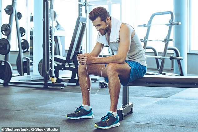 People commonly wear headphones during a weights session, on a run or while out on a bike ride and scientists found there are clear physical benefits to this (stock)