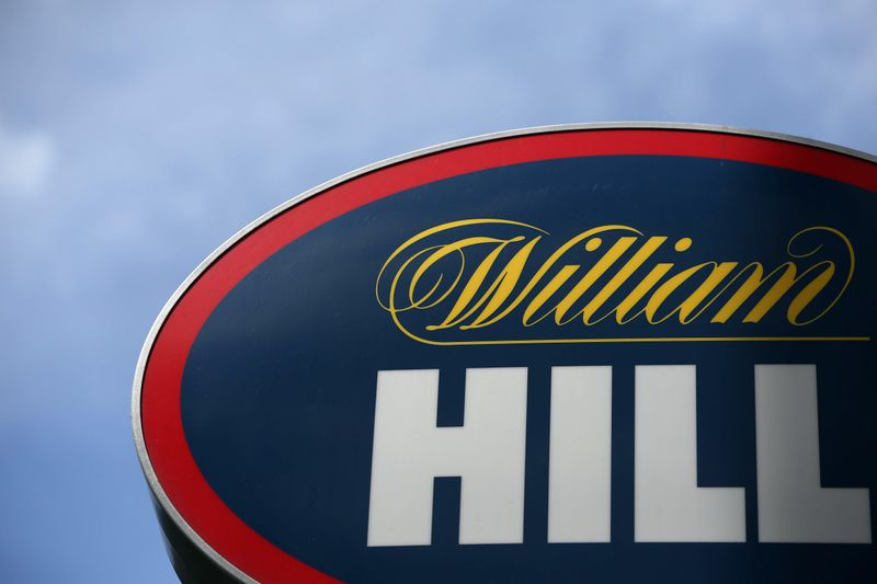 © Reuters. FILE PHOTO: A branded sign is displayed outside a William Hill betting shop in London