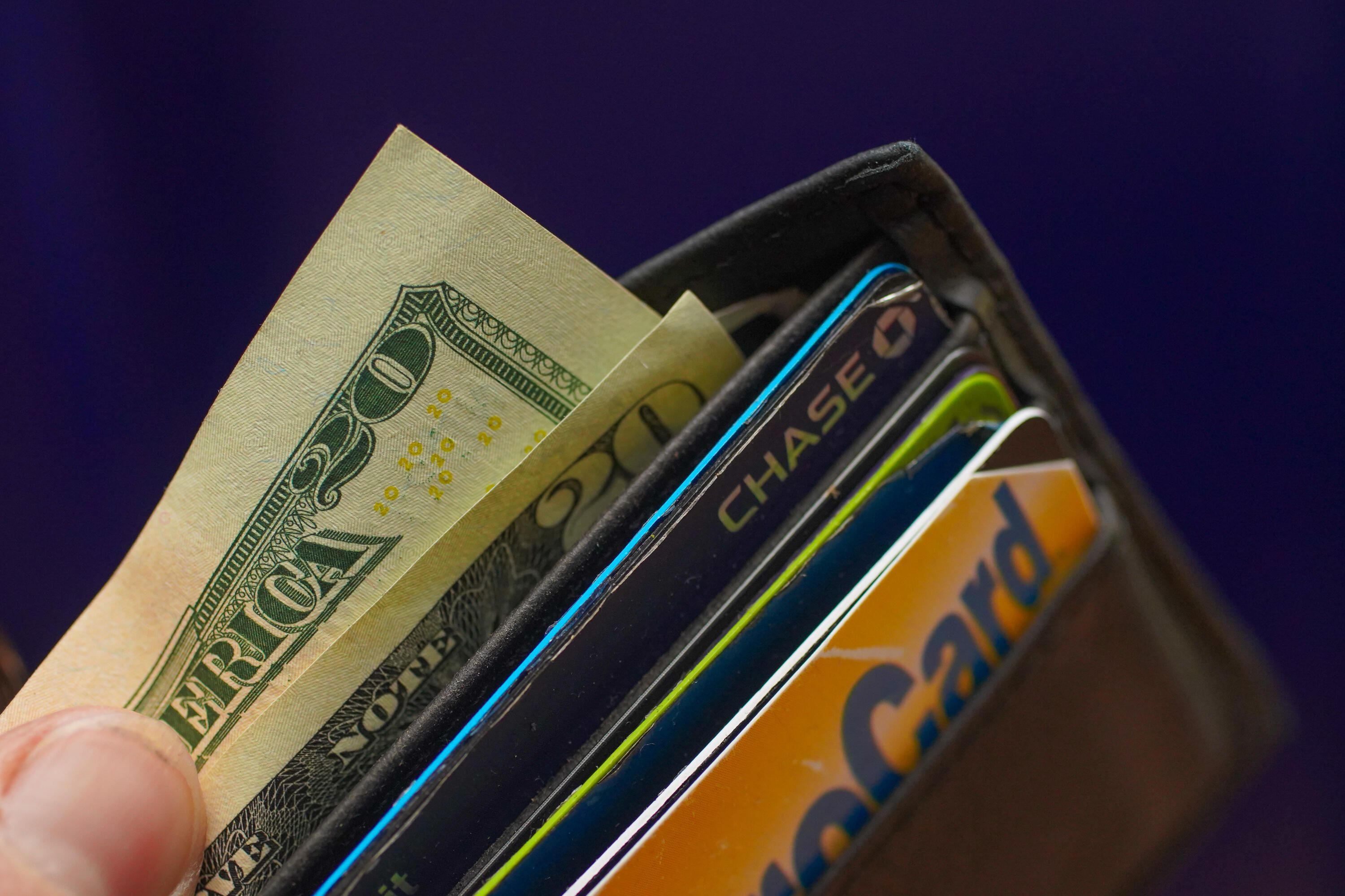 $20 bills and credit cards in a wallet