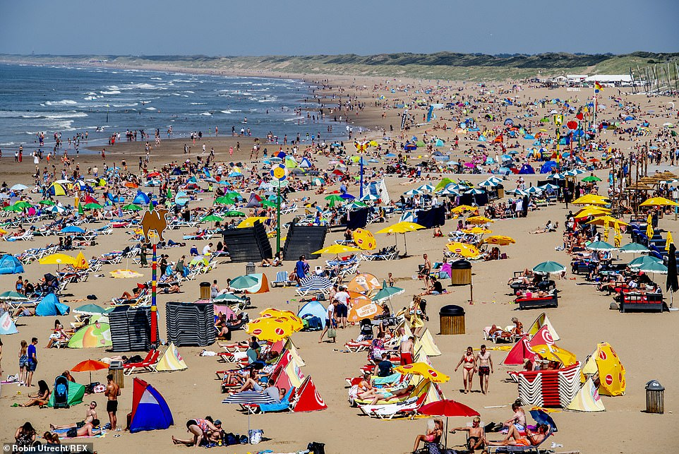 Vast crowds of people enjoyed the warm weather at Scheveningen beach in The Hague, Netherlands, amid the pandemic