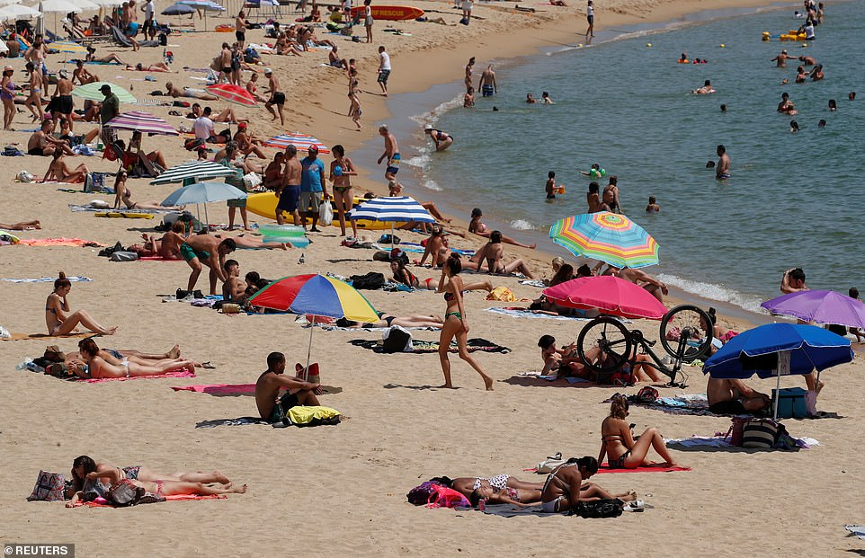 Sunskeekers soaked up the rays on the sand in Barcelona, Spain, on Thursday. Spain became the first country to be slapped with restrictions on Saturday after cases almost trebled in July, rising to almost 40 cases per 100,000 people last week. For comparison, the UK's rate per capita is roughly 15