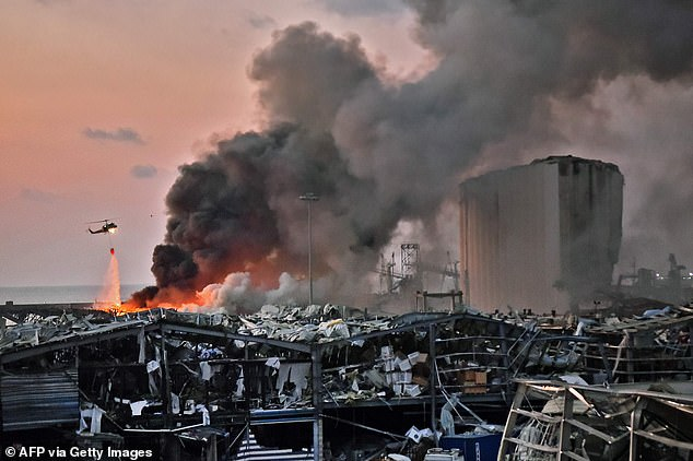 Firefighters spent the night battling blazes at the port, which were still burning as the sun came up on Wednesday