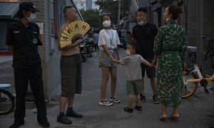 Visitors at a weekend open air market ask a local resident for directions in Beijing on Saturday, 8 August, 2020.