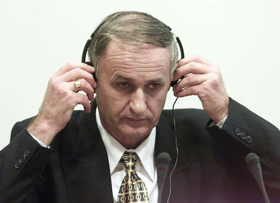 In this Thursday, Aug. 2, 2001 file photo, Bosnian Serb Gen. Radislav Krstic puts on headphones as he takes his seat in the courtroom in The Hague, Netherlands. Authorities in Bosnia on Wednesday, Sept. 16, 2020 arrested seven Bosnian Serb former military officers and troops suspected in the killing of 44 Bosniak civilians during the 1992-95 war. Among the suspects is Gen. Radislav Krstic, who is serving a 35-year-old prison sentence. In 2004, he was convicted by the U.N. war crimes tribunal for the former Yugoslavia on charges of aiding genocide. (Ed Oudenaarden, Pool Photo via AP, File) Photo: Ed Oudenaarden, AP / pool