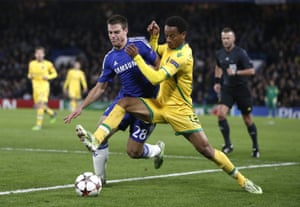 André Carrillo of Sporting challenges Chelsea's César Azpilicueta during their Champions League match at Stamford Bridge in December 2014.
