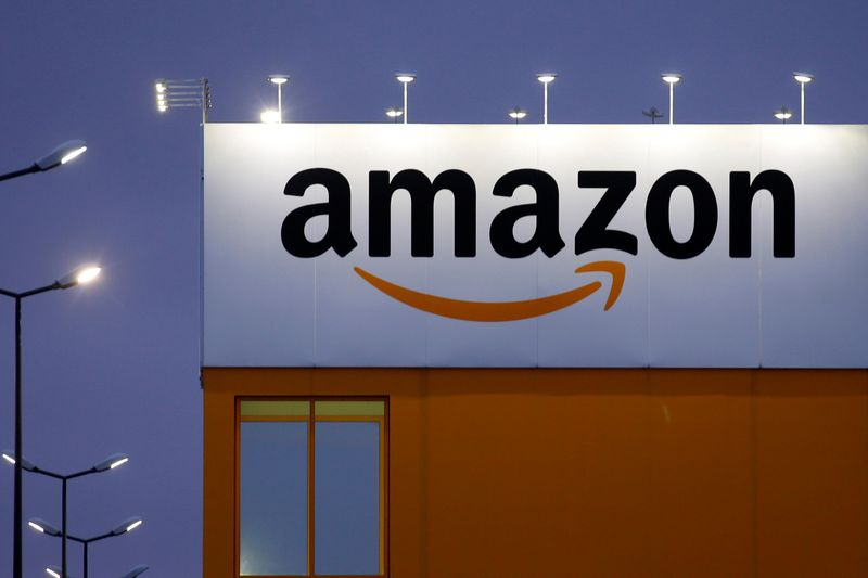 © Reuters. FILE PHOTO: The logo of Amazon is seen at the company logistics center in Lauwin-Planque, northern France