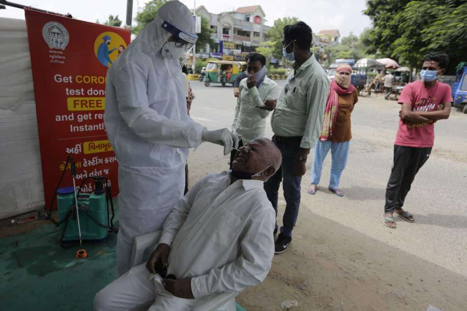 A health worker takes a nasal swab sample to test for COVID-19 test in Ahmedabad, India, Saturday, Sept. 26, 2020. The nation of 1.3 billion people is expected to become the pandemic's worst-hit country within weeks, surpassing the United States. Photo: Ajit Solanki, AP / Copyright 2020 The Associated Press. All rights reserved