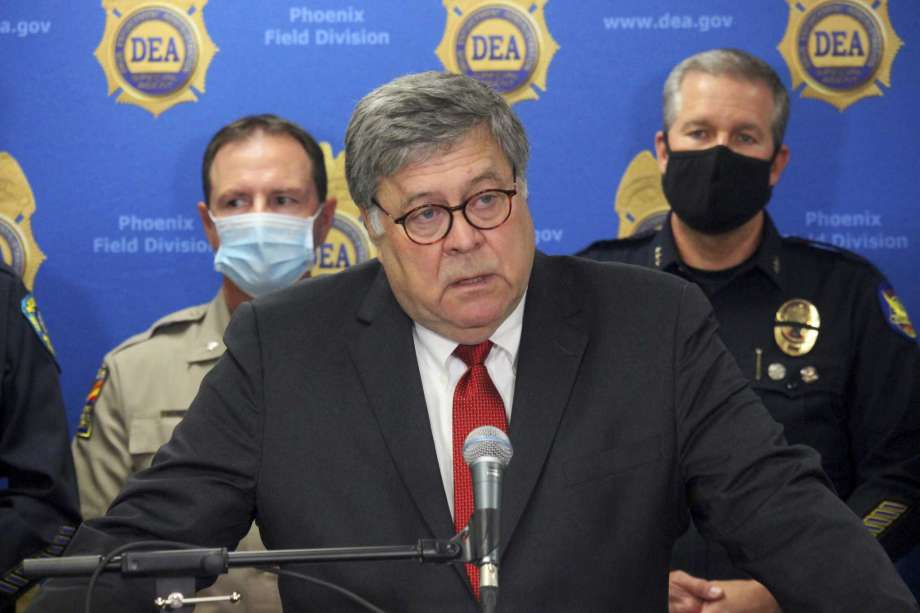 U.S. Attorney General William Barr speaks at a news conference, Thursday, Sept. 10, 2020, in Phoenix, where he announced results of a crackdown on international drug trafficking. Barr spent much of his time attacking mail-in voting, defending a Justice Department decision to take over defense of President Trump in a defamation case and discussing the civil unrest triggered by the killing of George Floyd by Minneapolis police in May. Photo: Bob Christie, AP / Copyright 2020 The Associated Press. All rights reserved.