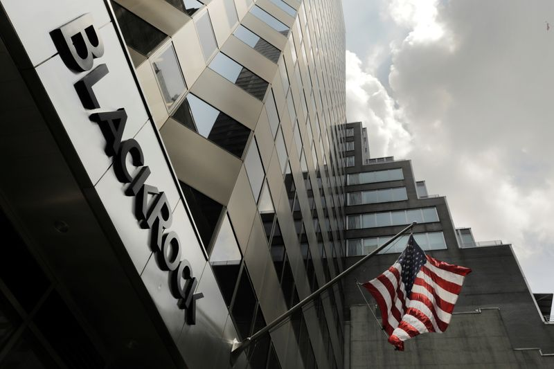 © Reuters. FILE PHOTO: A sign for BlackRock Inc hangs above their building in New York