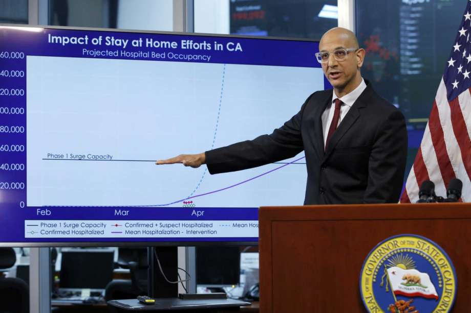 FILE - In this April 1, 2020, file photo, Dr. Mark Ghaly, secretary of the California Health and Human Services, gestures to a chart showing the impact of the mandatory stay-at-home orders, during a news conference in Rancho Cordova, Calif. Dr. Ghaly urged state residents to renew their efforts to prevent spread of the coronavirus amid some troubling trends, Friday, Sept. 25, 2020. Ghaly said infection rates are rising in some areas and one state model projects hospitalizations, now at their lowest level since early April, could increase nearly 90% in the next month. Photo: Rich Pedroncelli, AP / Copyright 2020 The Associated Press. All rights reserved