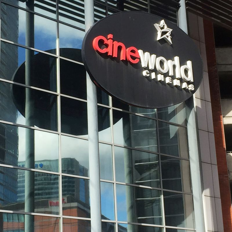 © Reuters. FILE PHOTO: A Cineworld cinema logo is pictured in Canary Wharf in London