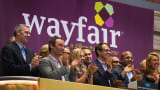Wayfair co-chairman and co-founders Steve Conine (C) and Niraj Shah applaud as they ring the opening bell above the floor of the New York Stock Exchange on the day of the company's IPO October 2, 2014.
