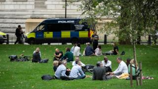 Groups of over six people socialise in Saint James' Park in Westminster on September 09, 2020 in London, England