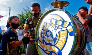 Fans of Atletico de San Luis play the drum as they cheer for their team before a Mexican Aperturna tournament football match against Monterrey, outside the Alfonso Lastras stadium in San Luis Potosi, Mexico, on 20 September 2020, amid the Covid-19 coronavirus pandemic.