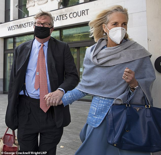 Support: Crispin Odey with his wife Nichola Pease outside court in London