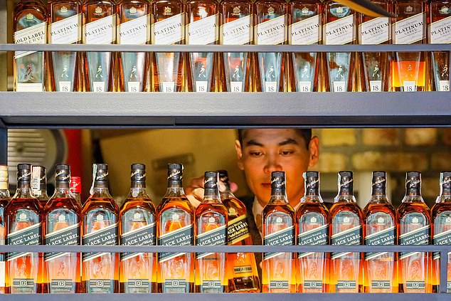 Drinking to success:The drinks business said it has been buoyed by 'robust demand' in the off-trade, which covers supermarkets and retail stores