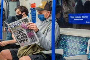 Passengers on the tube where masks are mandatory. Concerns grow over a potential second wave of coronavirus in the capital.
