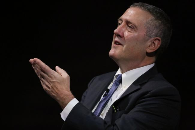 © Bloomberg. James Bullard, president and chief executive officer of the Federal Reserve Bank of St. Louis, gestures while speaking at the 2019 Monetary and Financial Policy Conference at Bloomberg's European headquarters in London, U.K., on Tuesday, Oct. 15, 2019. Bullard said U.S. policy makers are facing too-low rates of inflation and the risk of a greater-than-expected slowdown, suggesting he'd favor an additional interest rate cut as insurance.