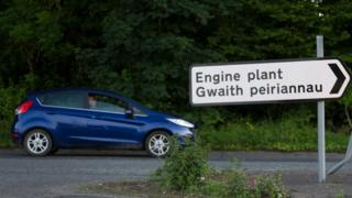 A Ford Fiesta next to the road sign for Bridgend Ford