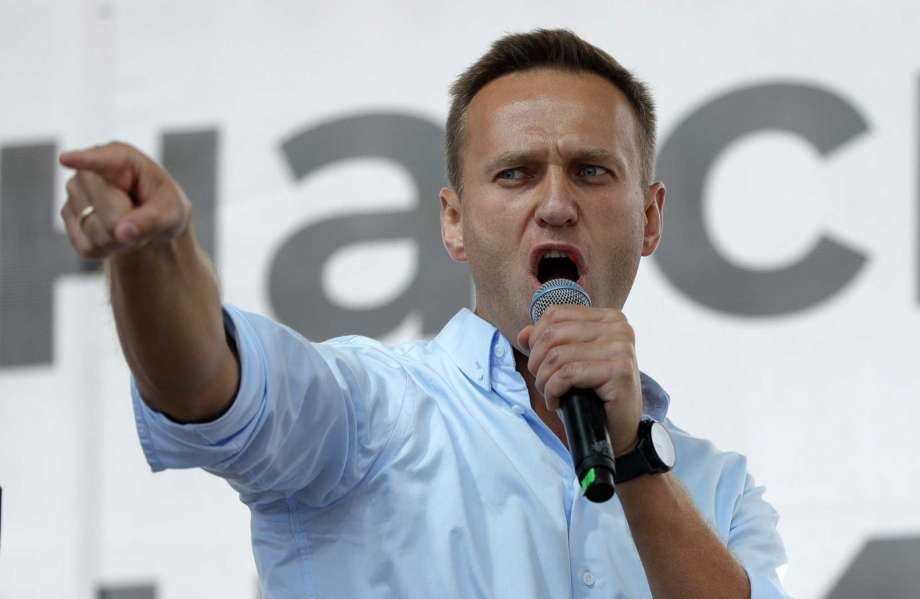 FILE - In this July 20, 2019, file photo, Russian opposition activist Alexei Navalny gestures while speaking to a crowd during a political protest in Moscow, Russia. Berlin's Justice Ministry has approved a request from Moscow for legal assistance in the investigation of the poisoning of opposition leader Alexei Navalny, and has tasked state prosecutors with working with Russian authorities. Photo: Pavel Golovkin, AP / Copyright 2019 The Associated Press. All rights reserved.