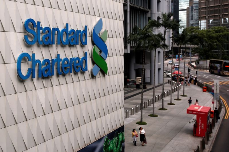 People walk outside the main branch of Standard Chartered in Hong Kong August 1, 2017. — Reuters pic