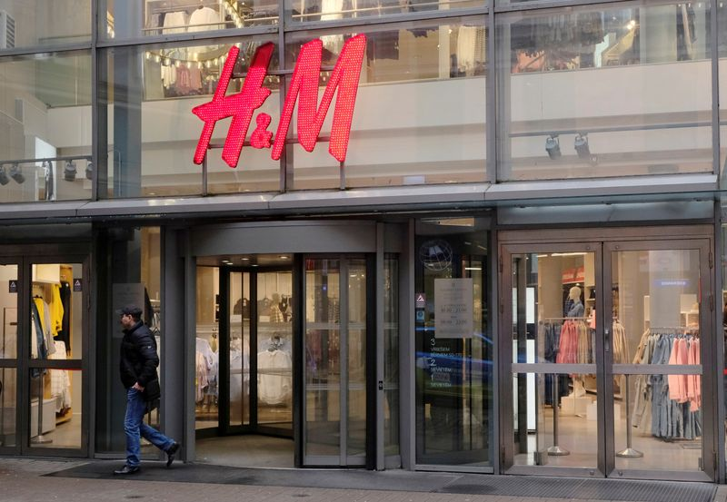 © Reuters. FILE PHOTO: A man leaves H&M shop in Riga