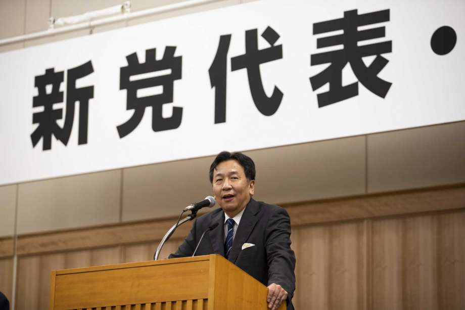 """Yukio Edano, the leader newly elected after two opposition parties' merger, speaks during a news conference in Tokyo on Thursday, Sept. 10, 2020. A 149-member group on Thursday chose Edano, a lawyer-turned politician, as new leader and decided to adopt the Constitutional Democratic Party of Japan, the name of the party he previously headed, as two main opposition parties merged.  The word, partly seen at top, read: """" New party leader"""". Photo: Hiro Komae, AP / Copyright 2020 The Associated Press. All rights reserved"""