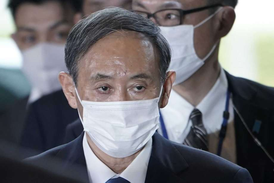 Yoshihide Suga arrives at the prime minister's office after being formally elected Japan's prime minister in a parliamentary vote, succeeding Shinzo Abe, Wednesday, Sept. 16, 2020, in Tokyo. Photo: Eugene Hoshiko, AP / Copyright 2020 The Associated Press. All rights reserved