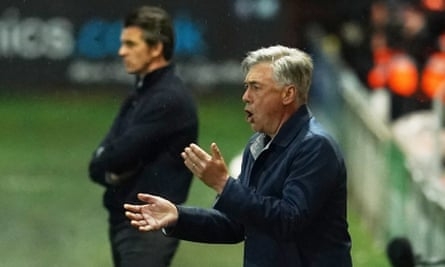 Carlo Ancelotti reacts alongside Fleetwood Town manager Joey Barton.