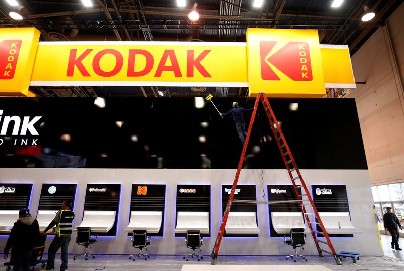 © Reuters. A worker cleans a Kodak booth at the Las Vegas Convention Center in preparation for 2019 CES in Las Vegas