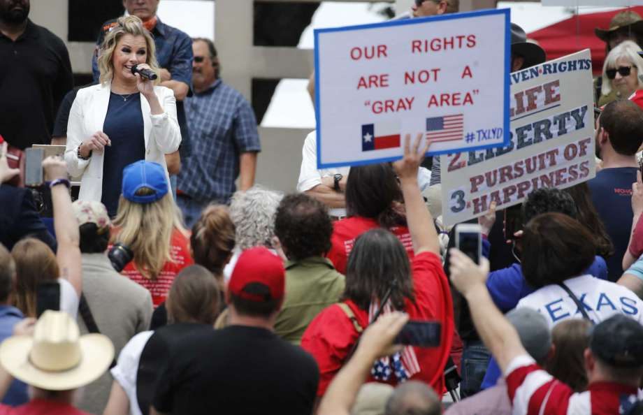 Shelley Luther, owner of Salon Á la Mode in Dallas speaks to the crowd during the Set Texas Free Rally at Dealey Plaza in Dallas, on Saturday, May 9, 2020. (Vernon Bryant /The Dallas Morning News via AP) Photo: Vernon Bryant, AP / THE DALLAS MORNING NEWS
