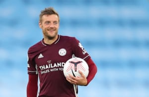 Leicester City's Jamie Vardy celebrates his hat-trick with the match ball.