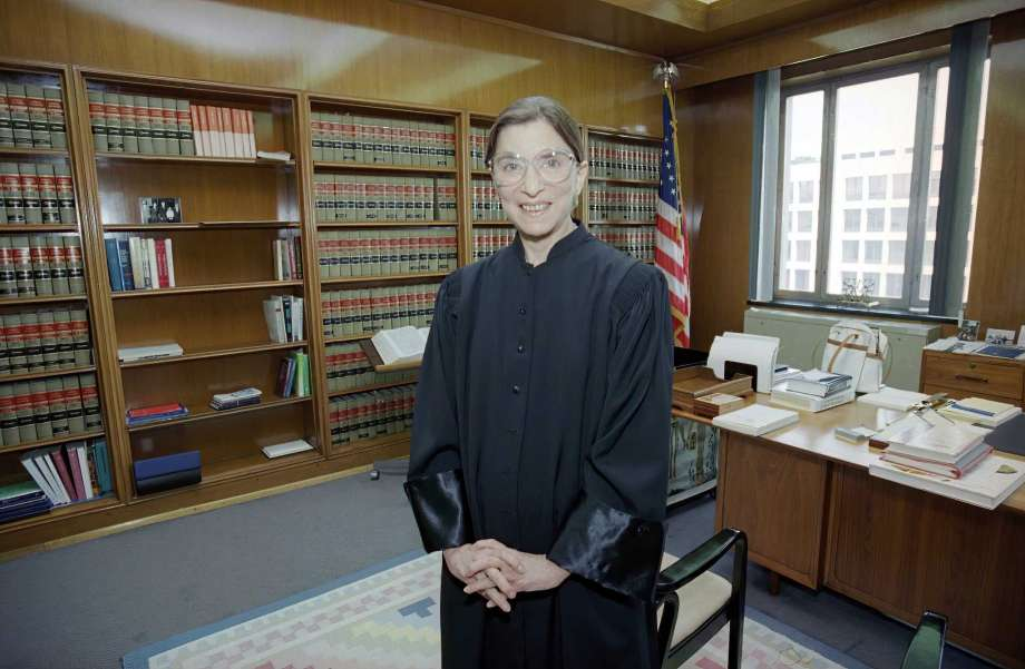 FILE- In this Aug. 3, 1993, file photo, then-Judge Ruth Bader Ginsburg poses in her robe in her office at U.S. District Court in Washington. Earlier, the Senate voted 96-3 to confirm Bader as the 107th justice and the second woman to serve on the Supreme Court. Ruth Bader Ginsburg died at her home in Washington, on Sept. 18, 2020, the Supreme Court announced. Photo: Doug Mills, AP / AP1993